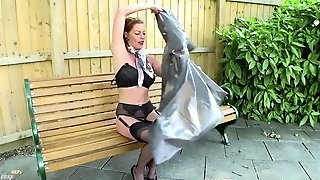 Deviant Mummy Holly Smooch Takes Off Pvc Mac And Wanks Openly On Public Bench In Black Nylons Garters And Fuck Me Stilettos